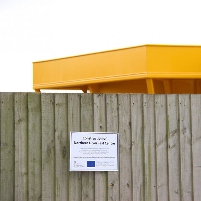 Northern Diver Diving Test Tank: EU funding plaque, outside on our wooden fence