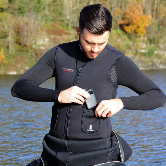 Rechargeable warm heated vest for use both on the surface and under water.